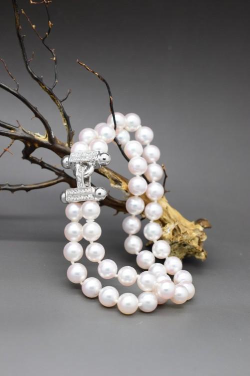 Bracciale di perle sferiche bianche a due fili